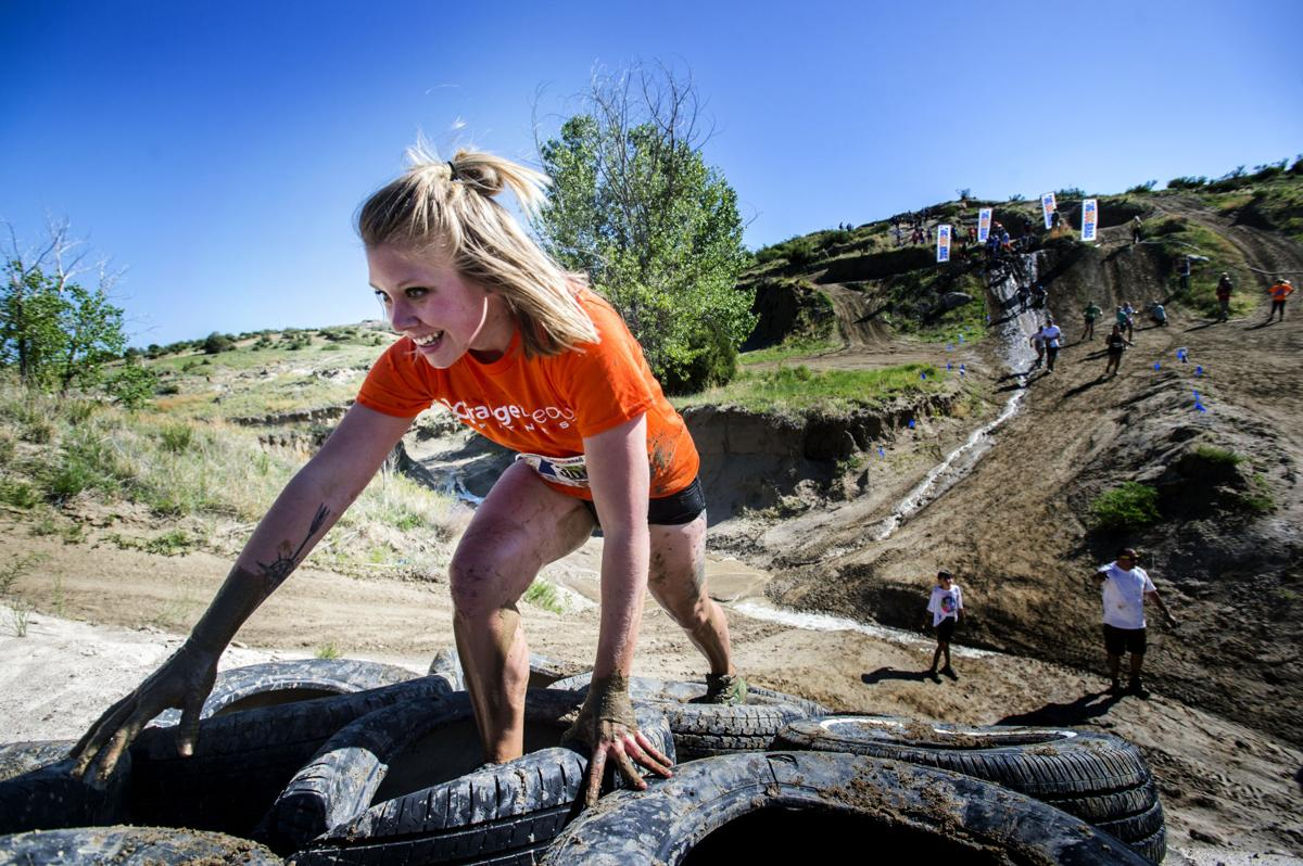 A runner climbs the Tired Hill Saturday, June 3, 2017, during the Big Dog Brag mud run in Colorado Springs. The next run is in Pueblo June 24 and for more information visit bigdogbrag.com. See Gazette.com for a photo gallery from Saturday's event. (The Gazette, Christian Murdock)