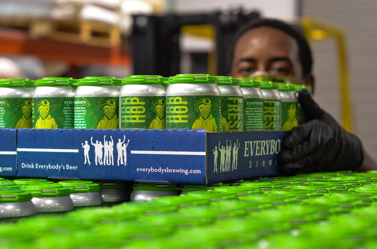 09-30 the ale lit everybodys Brew Crew stacks pallet of Head Stash 6-packs.jpg