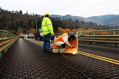 Welding crews work on the Hood River-White Salmon Bridge