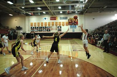 Natasha Muzechenko shoots a three-point jumper