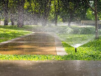 09-23 soil and water conservation story sprinkler-watering-pavement.jpg