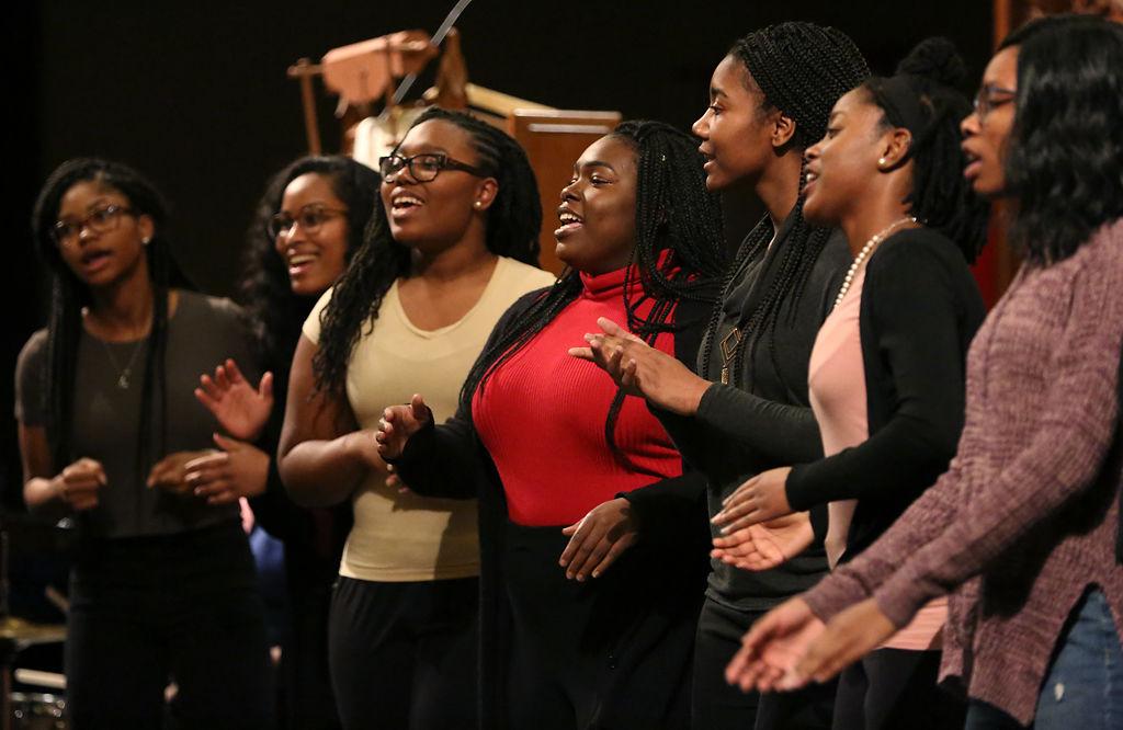 Seven members of MU's Legion of Black Collegians Gospel Choir sing