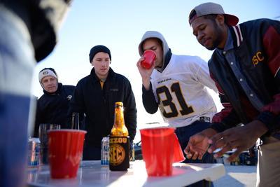 Trey Pfleging drinks his beer