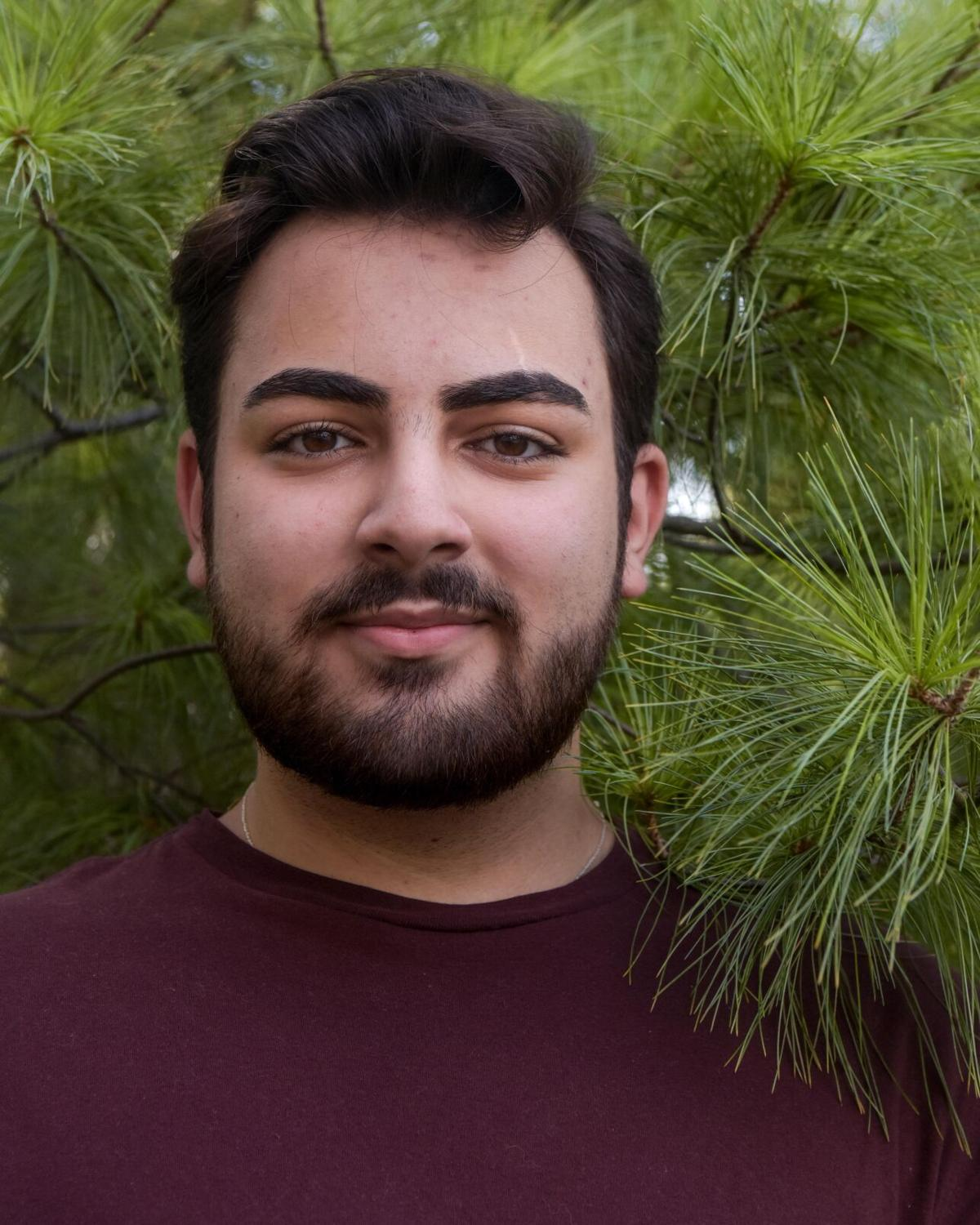 Hickman High School senior Dany Dakhlallah stands for a portrait