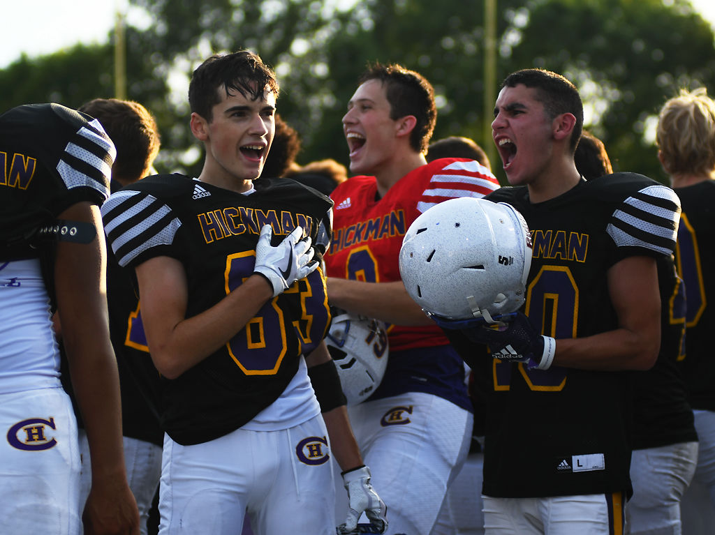 Hickman's Carrig Irelan, left, and Felix Pippenger scream after the national anthem finishes