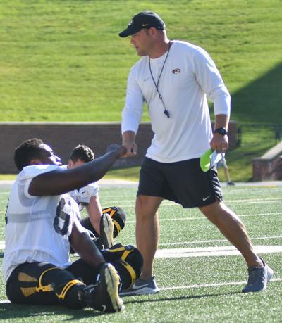 Head Coach Barry Odom fist bumps Offensive Lineman Richard Taylor