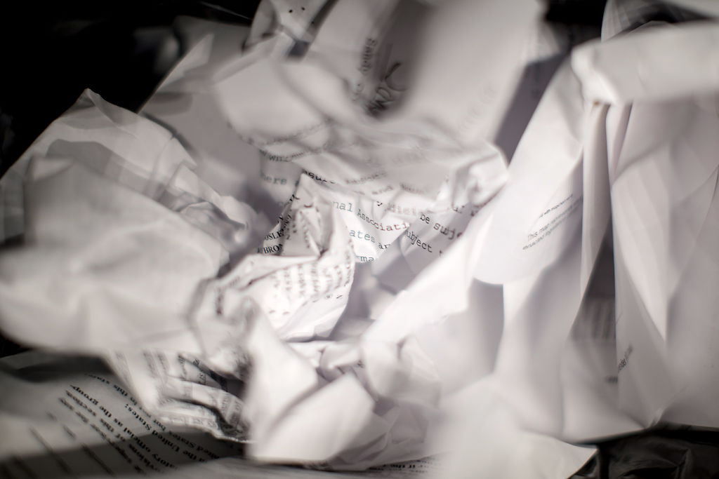 Crumpled paper lies in a waste bin after the Missouri legislature's session ends