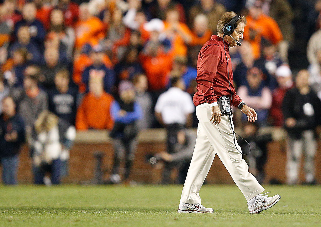 Alabama coach Nick Saban walks off the field with his head down during the