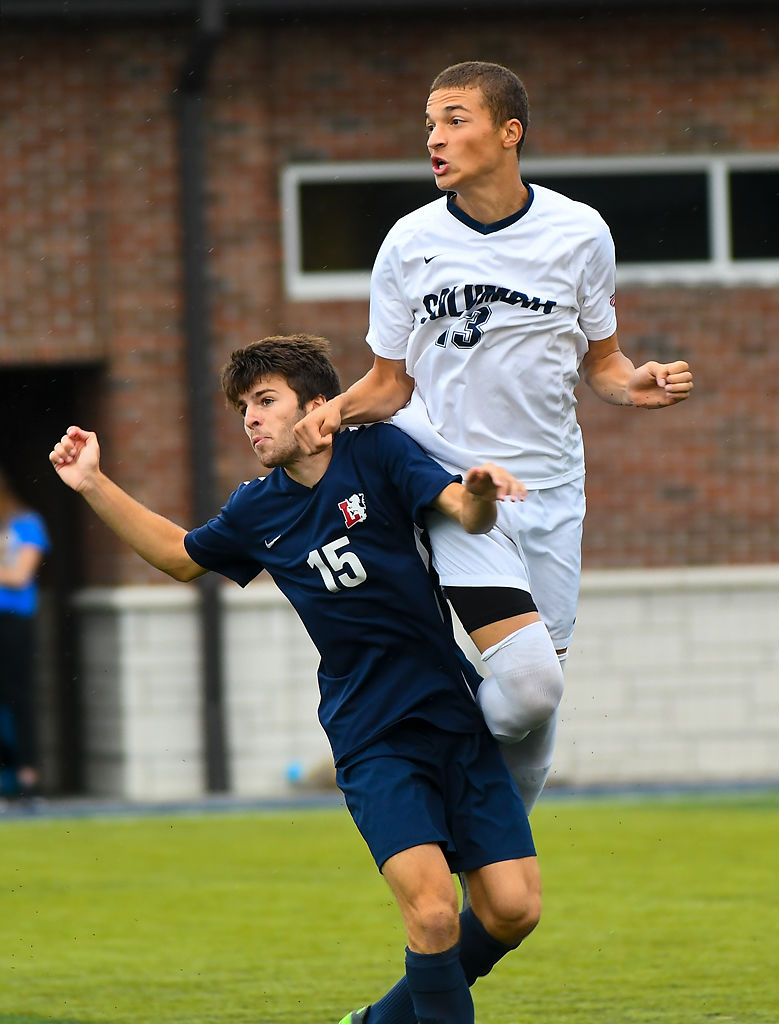 Lyon College forward Marcos Fernandez and Columbia College defender Carson Lindsey jump to block the ball