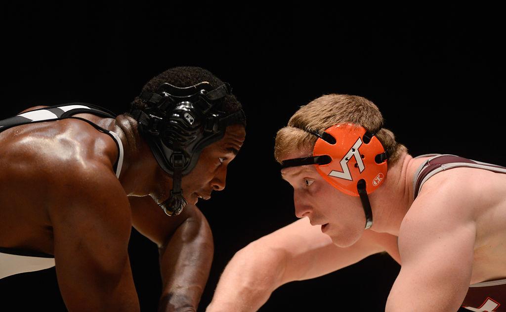 J'den Cox grapples with wrestler Jared Haught