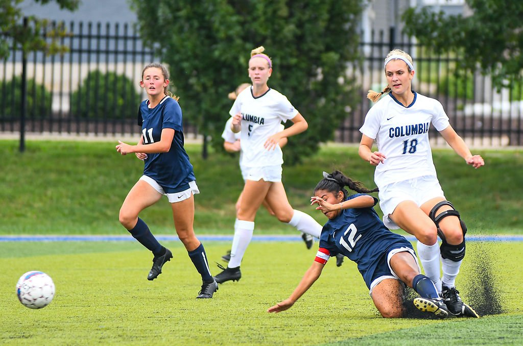 Columbia College forward Kelsey Mirts and Lyon College defender Elena Cervantes vie for the ball