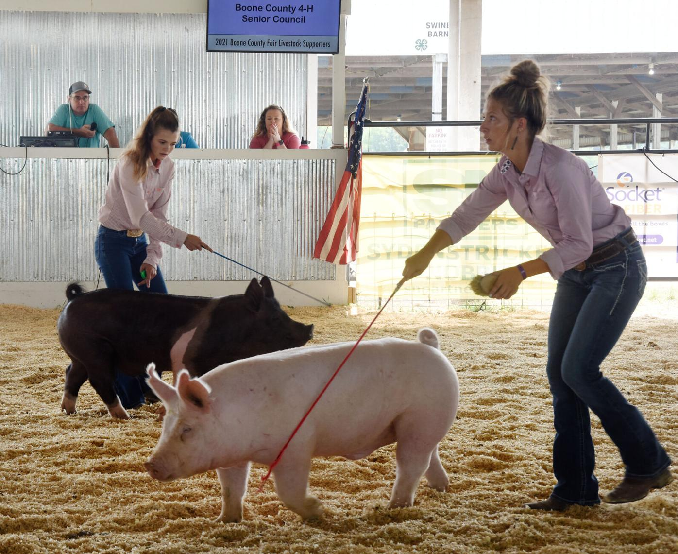 Blair Schnarre and Charlie Hazelrigg direct pigs around the ring