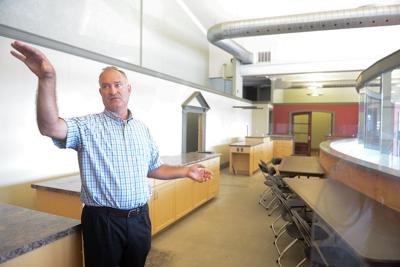 Mike Reynolds, the new director of the Goodwill Excel Center, gives a tour of a new classroom