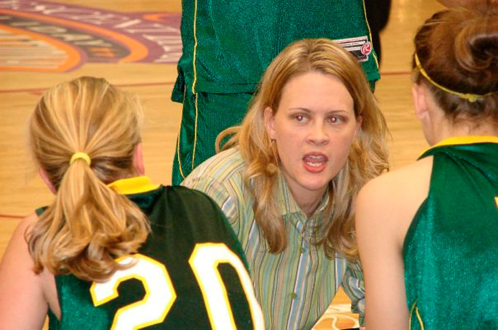 Jill Nagel kneels and talks with her Rock Bridge players during the State Championship game in 2008.