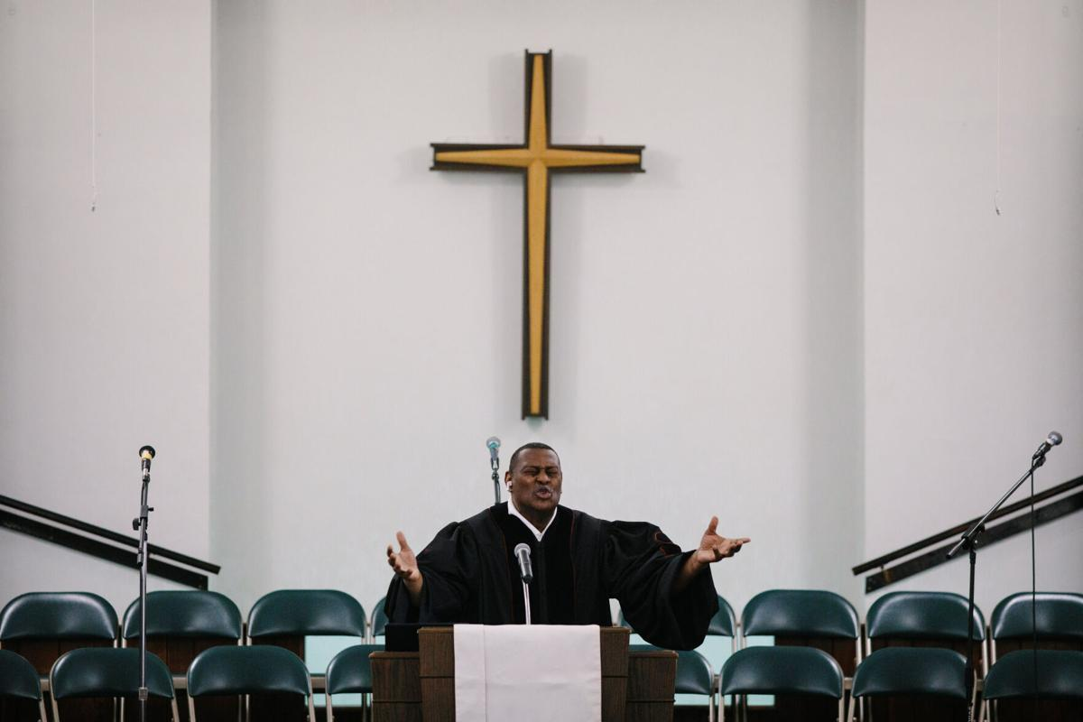 Rev. Rodrick Williams Sr. outstretches his arms