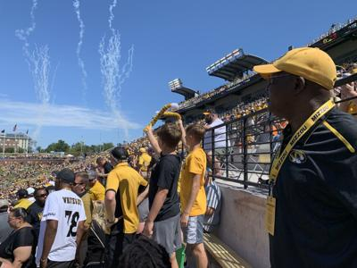Albert Okwuegbunam Sr. watches Missouri versus West Virginia
