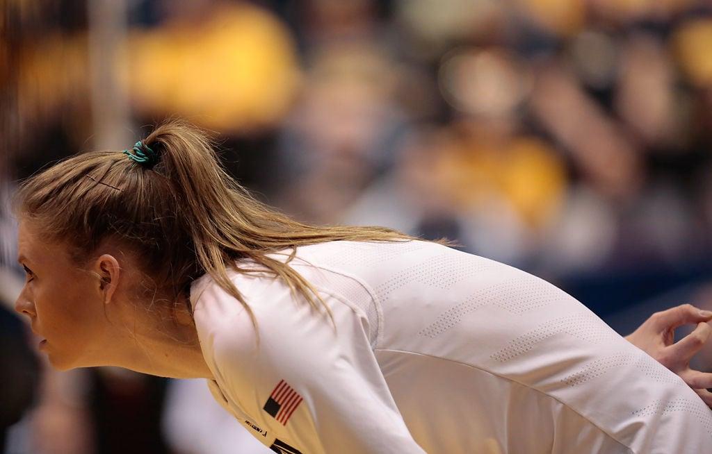 Melanie Crow stares through the net