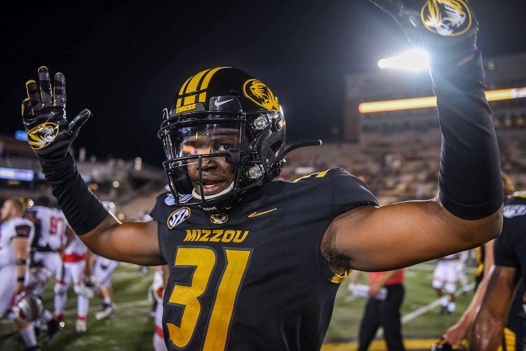 Missouri defensive back Martez Manuel raises his hands in elation
