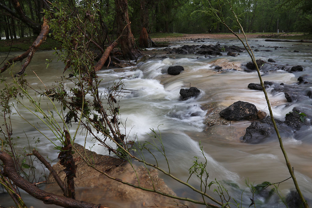 Running water from Pike Creek and the Current River rush over rocks