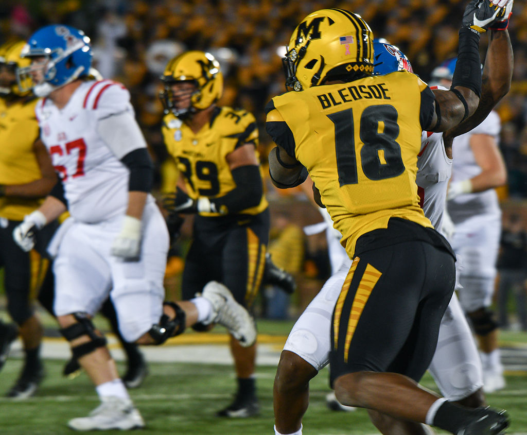Missouri Safety Joshuah Bledsoe grapples with a defender