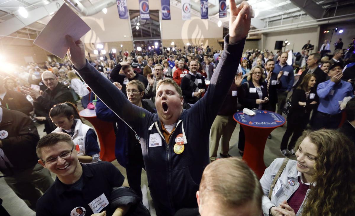 Josh Kent celebrates Ted Cruz during the Iowa Caucus