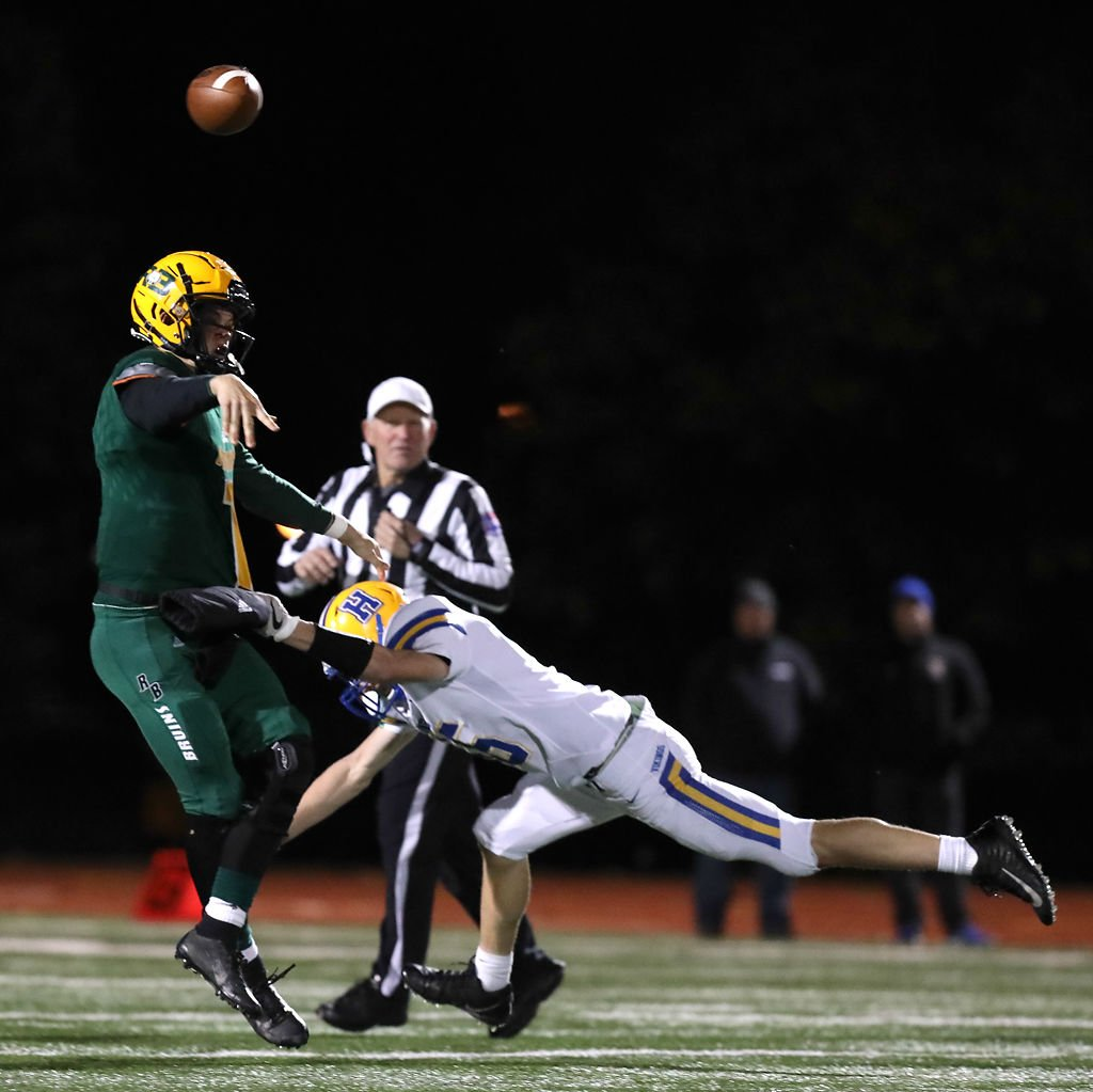 Grant Hajicek, Rock Bridge High School quarterback, throws the ball away