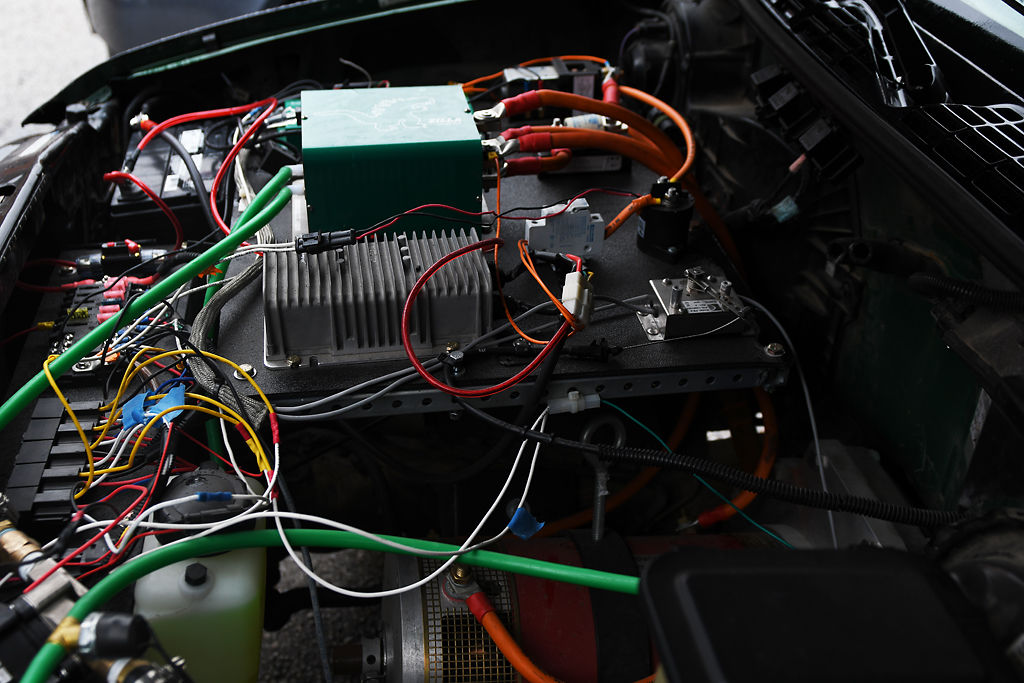 Wires and batteries replace the engine of the Mizzou Electric Car Team's Chevy ...