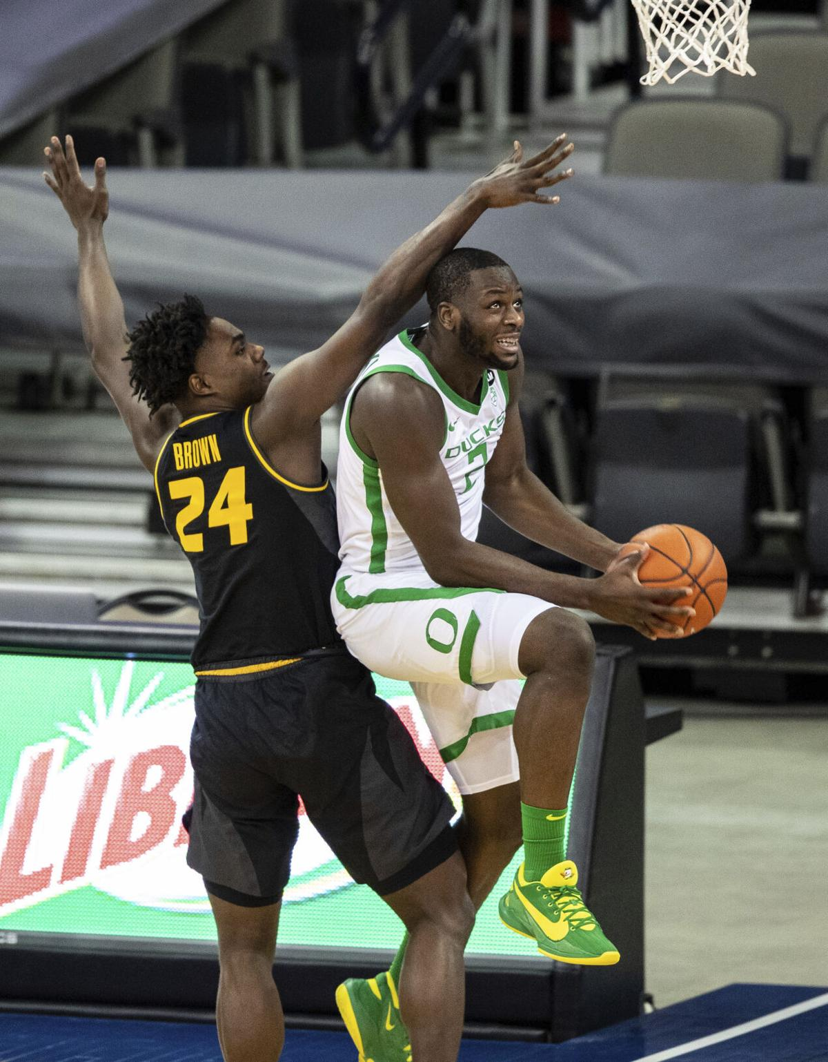 Missouri's Kobe Brown (24) fouls Oregon's Eugene Omoruyi during an NCAA college basketball game, Wednesday, Dec. 2, 2020 in Omaha, Neb.