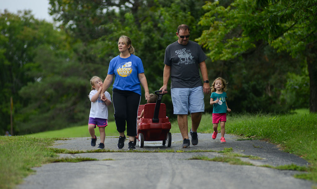 Isabella, Anette, Logan, Carl and Bailey Jackson stroll on Saturday at Cosmo Park
