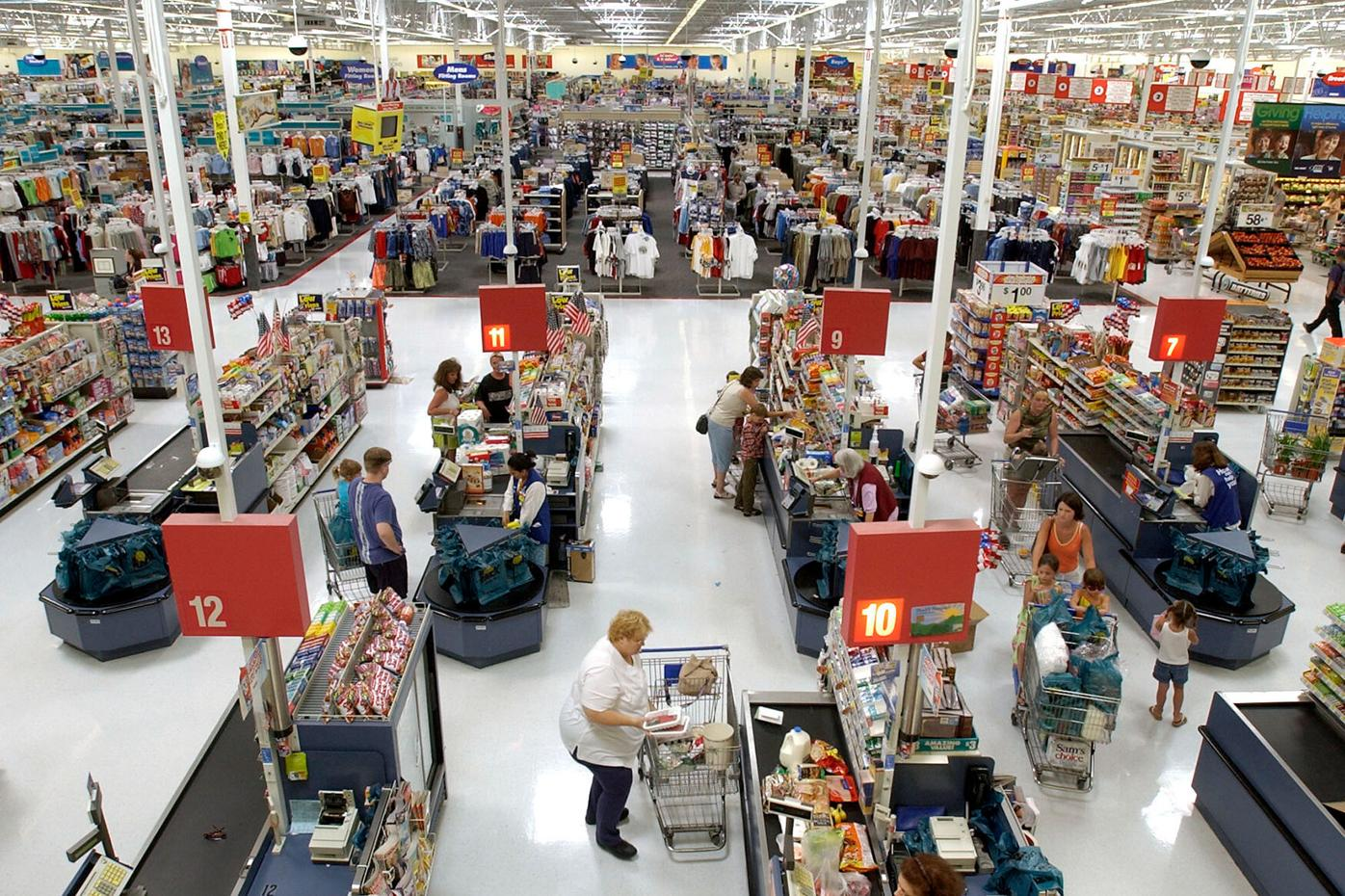 Shoppers check out at the counters of the Wal-Mart supercenter