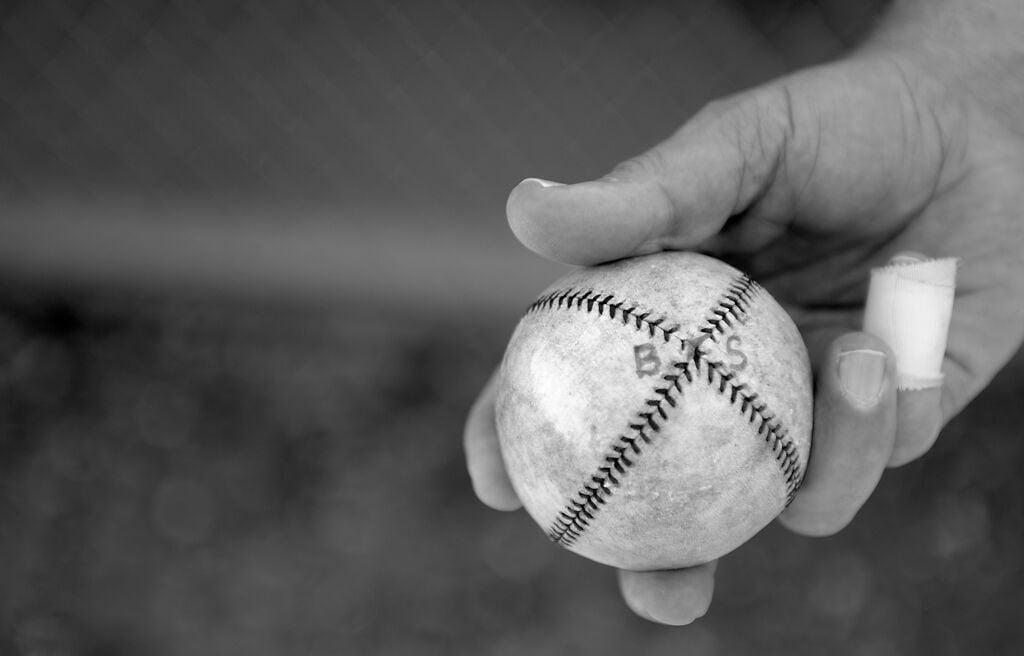 Adrian 'Law Dog' Sulser holds a vintage baseball
