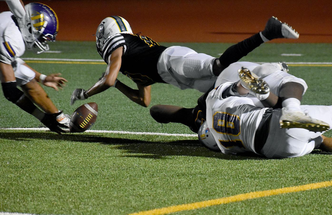 Battle sophomore Alex Fernandez dives over