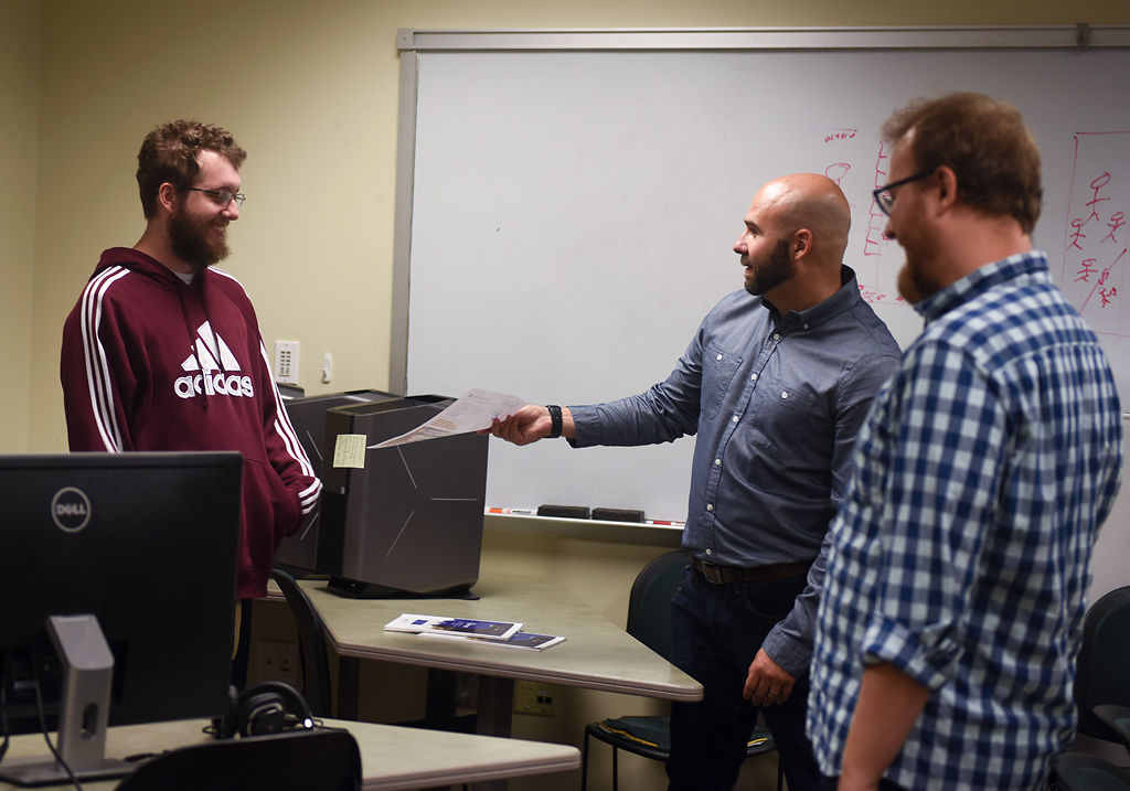 Jonuthan Breedlove, left, Joe Griffin, Justin Sigoloff, right, talk about their gaming program