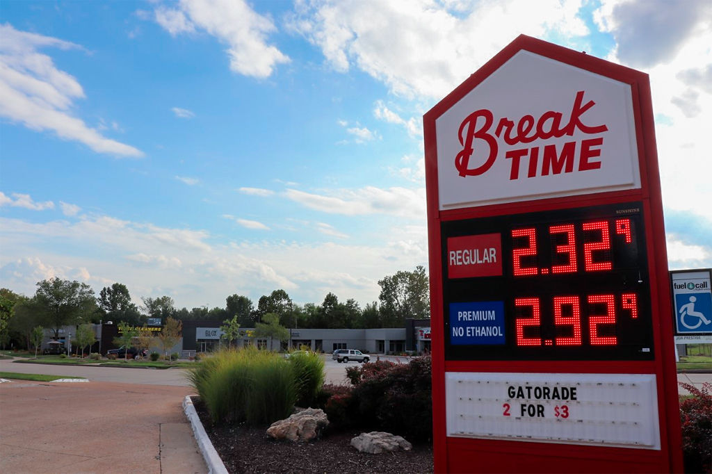A sign shows the prices of gas at the Break Time