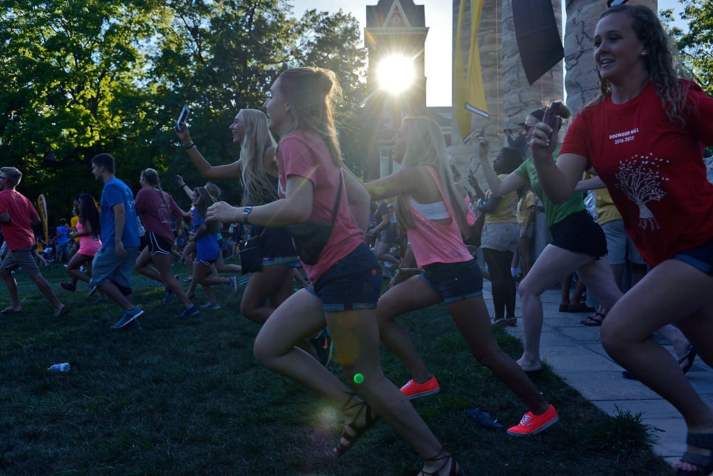 Students run through the MU Columns