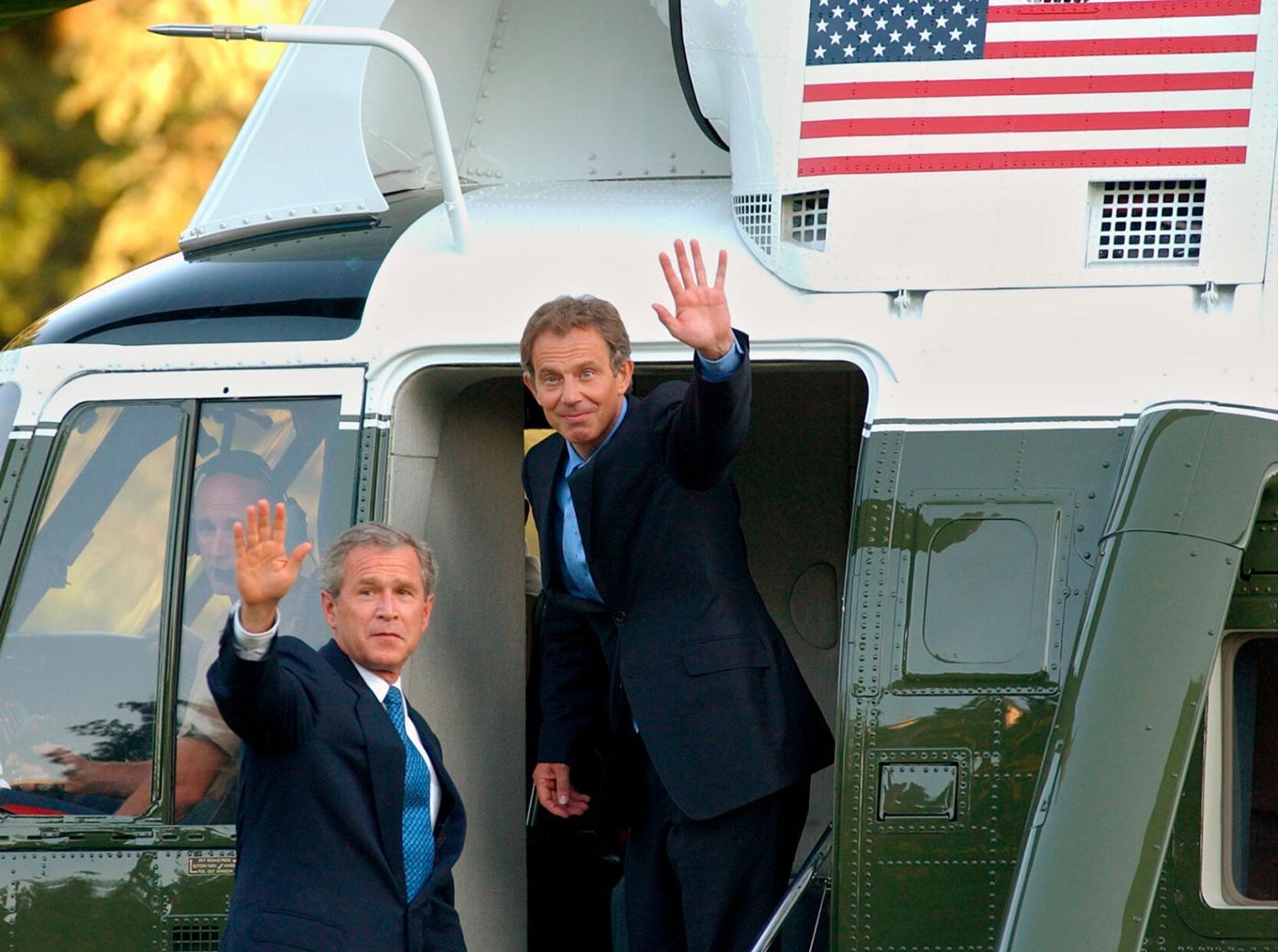 President Bush and British Prime Minister Tony Blair wave