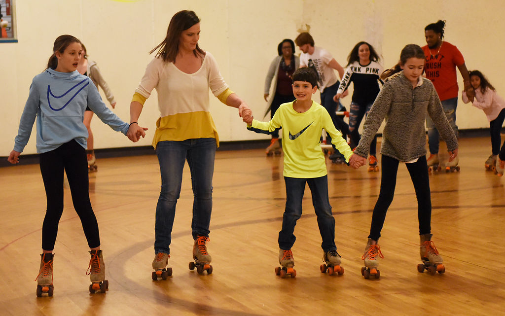 Tricia Sexauer skates with her children Sadie, Robert and Lexi