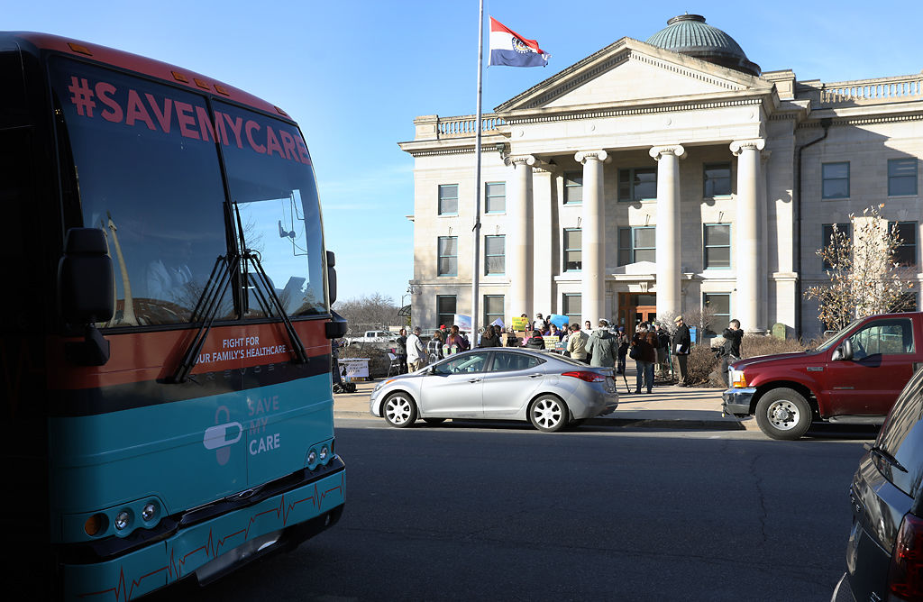 The Save My Care bus parked across from the county courthouse