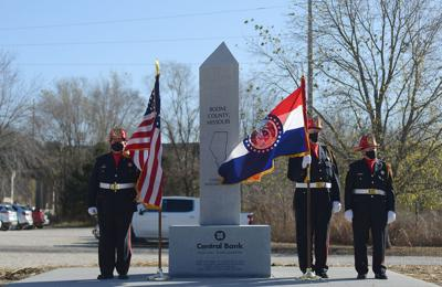 Nathan Luebbering, Gary Berendzen and Steve Cearlock with the Cole County Honor Guard stand by the bicentennial statue