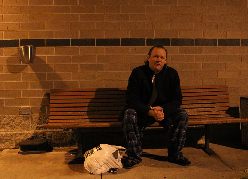 Seth Reynolds waits on a bench outside Boone County Jail
