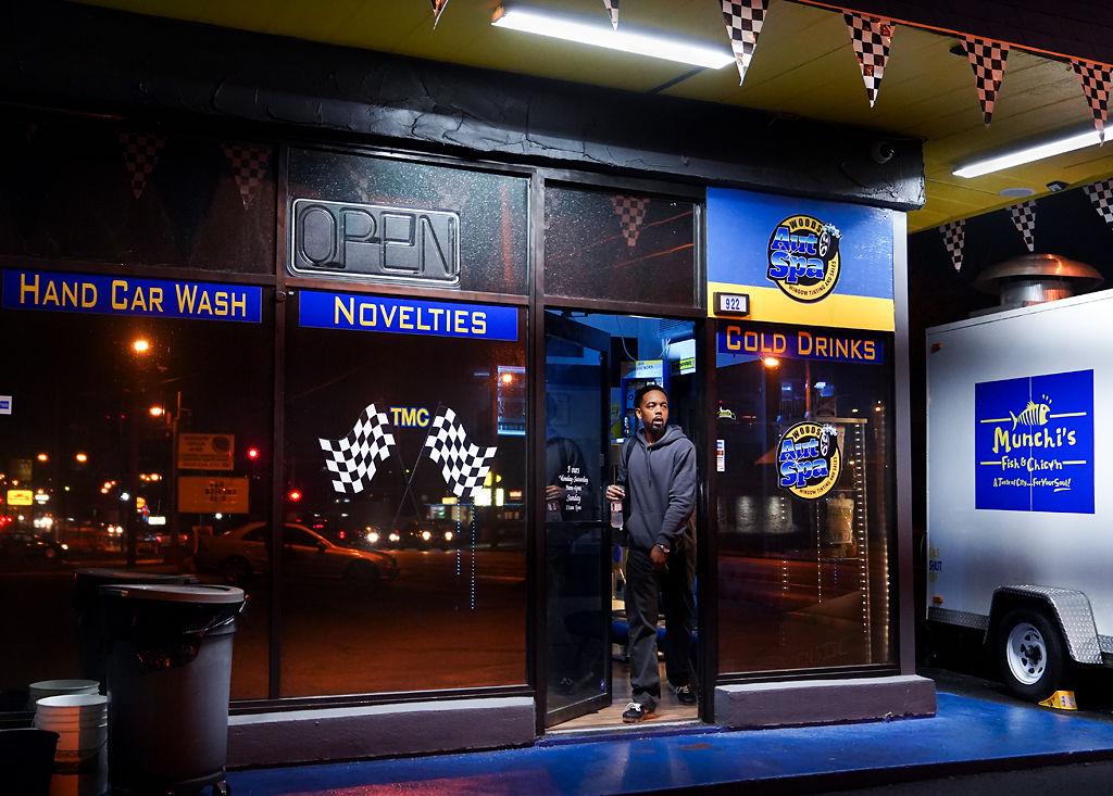 Dimetrious Woods exits his shop