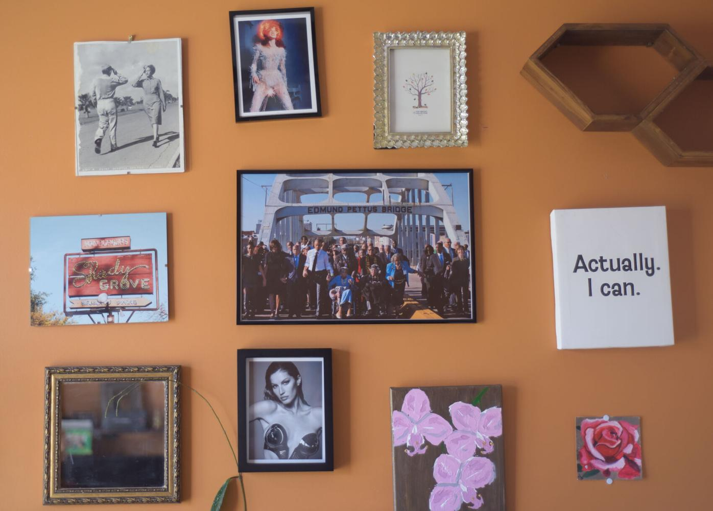 Paintings and photography hang on the wall of Dr. Nancy Cheak-Zamora's office space