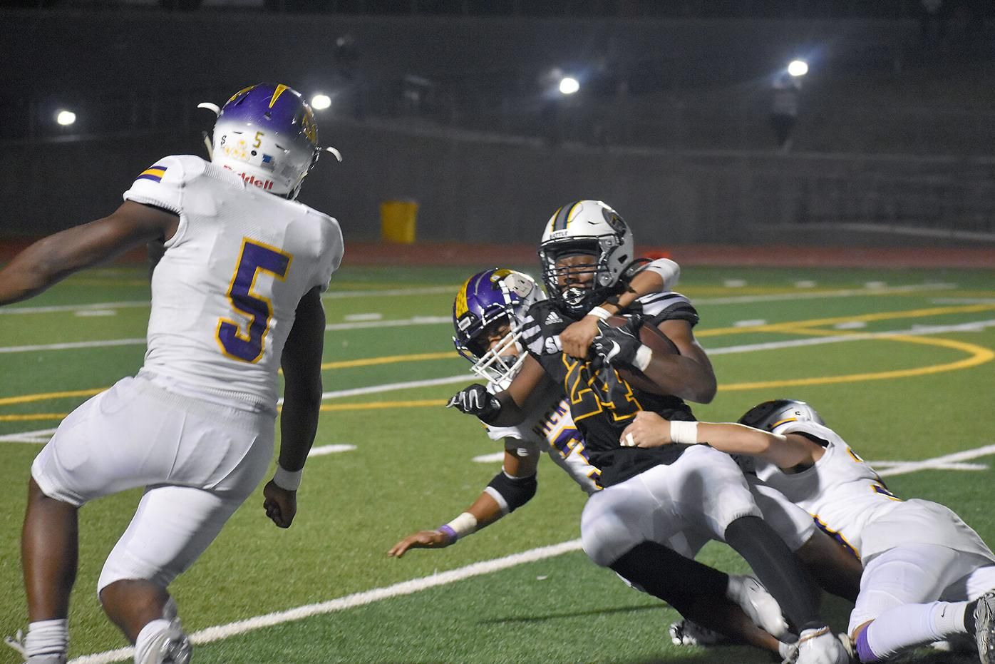 Battle senior Tre Richardson is tackled with the