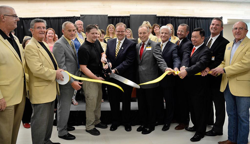 Missouri Orthopaedic Institute patient Matt Boehner cuts the opening ribbon