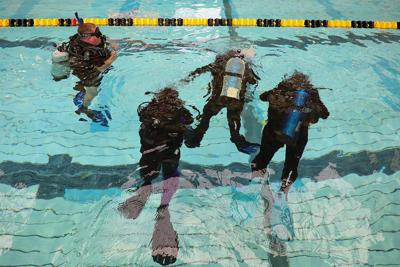 Taking the plunge: scuba divers work towards certification