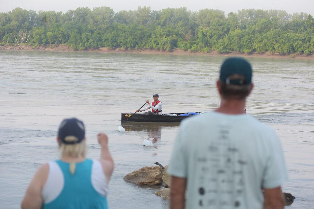 Edoh Amiran paddles to shore