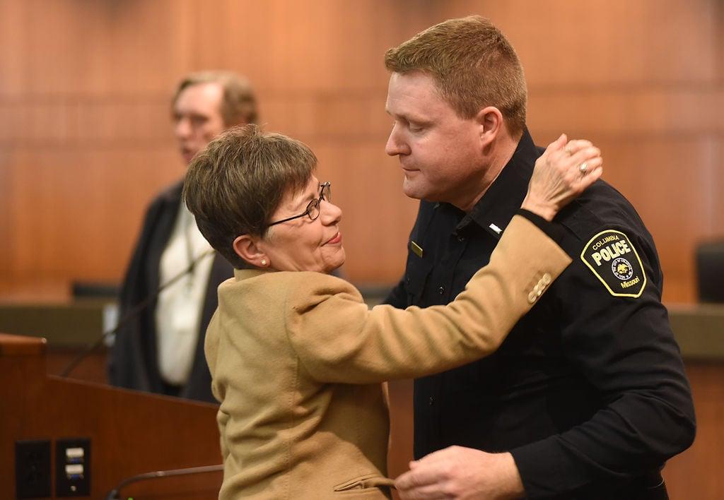 Columbia Civic Relations Manager Toni Messina congratulates new interim Police Chief Geoff Jones