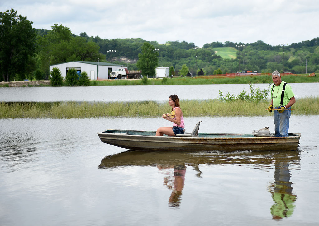 Kim Baumgartner and Jim Epple row down the flooded plain