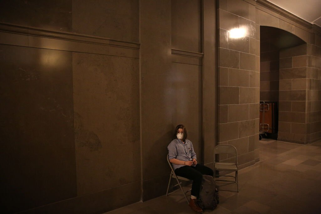 Miles sits outside the Senate Committee Room 1