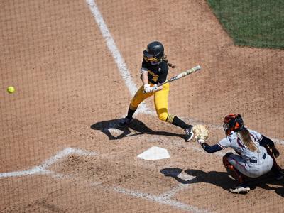 Janna Laird swings the bat